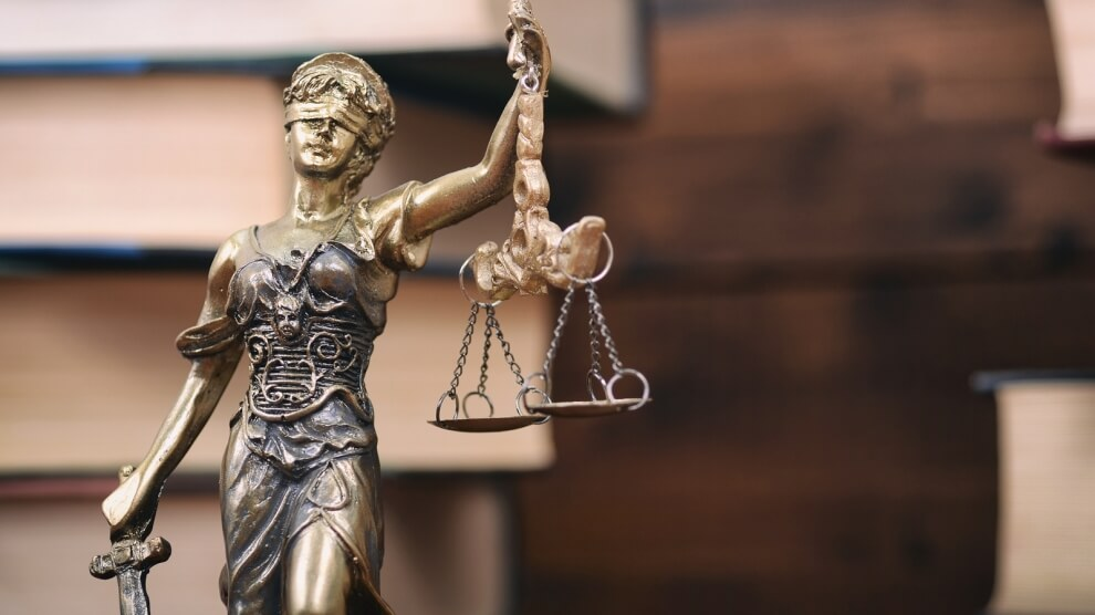 bigstock-law-and-justice-scales-of-jus-241531561-990x556