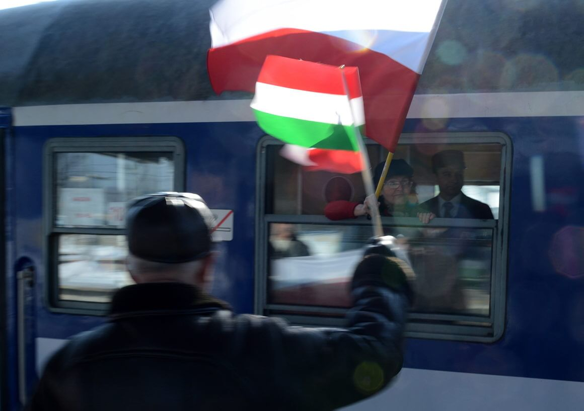 epa03623369 Polish sympathizers of Hungary and the government of Viktor Orban with Polish and Hungarian flags attend in 2nd Great Journey to Hungary at the Railway Station in Warsaw, Poland, 14 March 2013. Poles will take part in Hungary's National Day celebrations on 15 March.  EPA/JACEK TURCZYK POLAND OUT