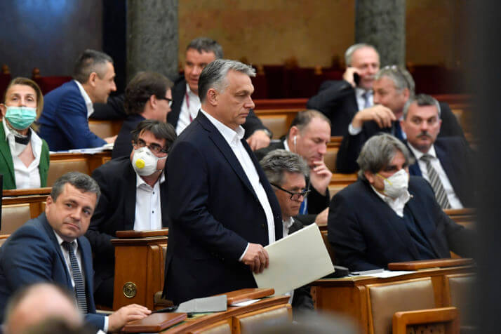 epa08332120 Hungarian Prime Minister Viktor Orban (C) arrives for the plenary session of the Parliament in Budapest, Hungary, 30 March 2020. Reports state MPs approved legislation that extends a state of emergency and gives the government extraordinary powers due to the ongoing pandemic of the Covid-19 disease caused by the SARS-CoV-2 coronavirus.  EPA-EFE/Zoltan Mathe HUNGARY OUT